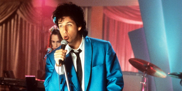 "Adam Sandler sings in a scene from ""The Wedding Singer,"" 1998."