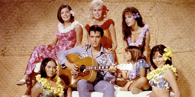 """Elvis Presley and other castmembers appear on the set of the 1966 film """"Paradise, Hawaiian Style."""" (Getty Images)"""