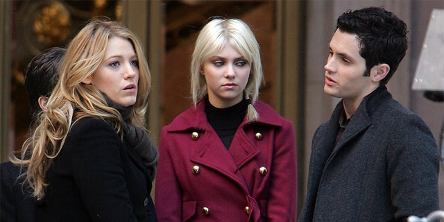 "Penn Badgley (right) on the set of ""Gossip Girl."""