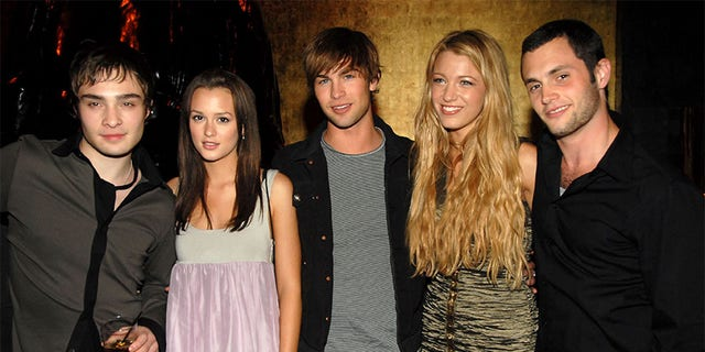 "Penn Badgley (right) with his former ""Gossip Girl"" castmates."