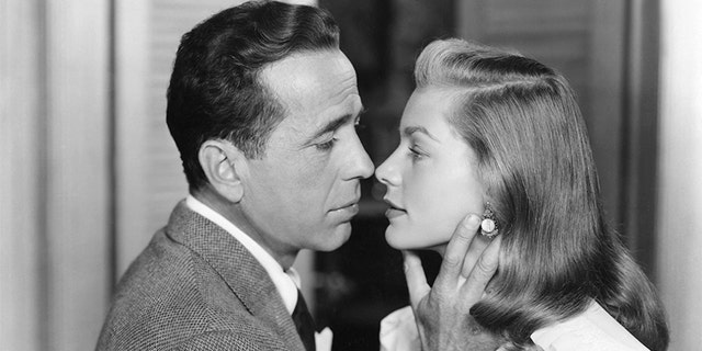"""Lauren Bacall with husband Humphrey Bogart in """"The Big Sleep,"""" which was directed by Howard Hawks."""