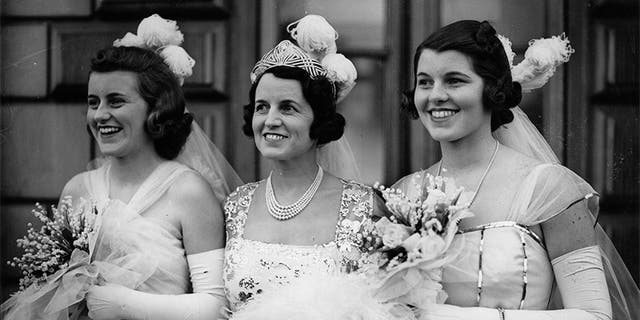 Rose Kennedy (center), mother of John F. Kennedy, poses with two of her daughters: Kathleen (left) and Rosemary (right).