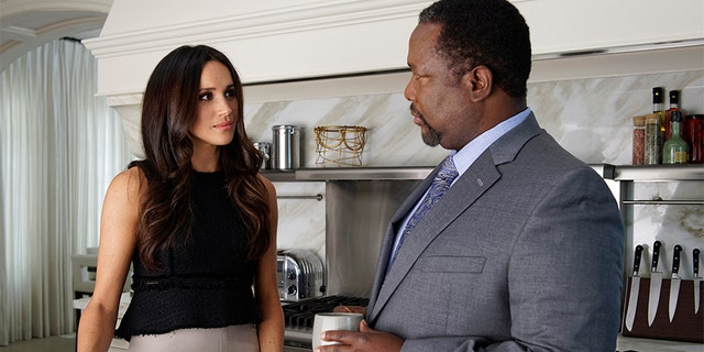 "Meghan Markle and Wendell Pierce on the set of ""Suits."""