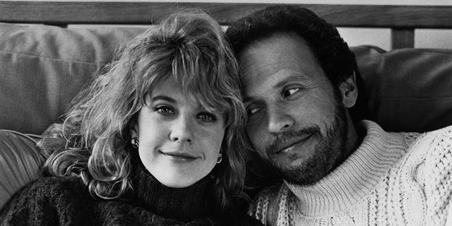 "Meg Ryan and Billy Crystal posing for the movie ""When Harry Met Sally"" circa 1989."