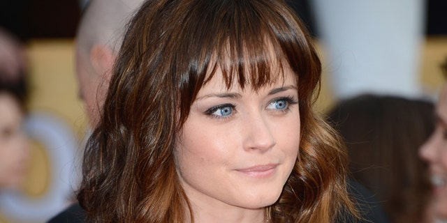 Actress Alexis Bledel arrives at the 19th Annual Screen Actors Guild Awards held at The Shrine Auditorium on January 27, 2013 in Los Angeles, California.  (Photo by Frazer Harrison/Getty Images)