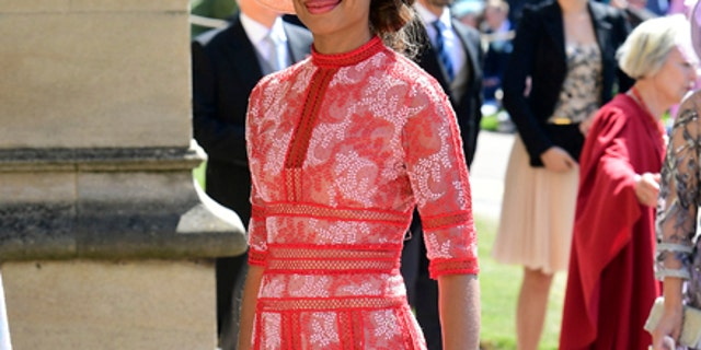 Gina Torres arrives for the wedding ceremony of Prince Harry and Meghan Markle at St. George's Chapel in Windsor Castle in Windsor, near London, England, Saturday, May 19, 2018. (Ian West/pool photo via AP)