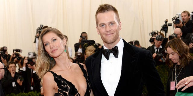 """NEW YORK, NY - MAY 05:  Model Gisele Bundchen (L) and NFL player Tom Brady attend the """"Charles James: Beyond Fashion"""" Costume Institute Gala at the Metropolitan Museum of Art on May 5, 2014 in New York City.  (Photo by Dimitrios Kambouris/Getty Images)"""