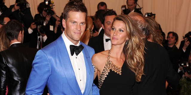 "NEW YORK, NY - MAY 06:  NFL player Tom Brady (L) and model Gisele Bundchen attend the Costume Institute Gala for the ""PUNK: Chaos to Couture"" exhibition at the Metropolitan Museum of Art on May 6, 2013 in New York City.  (Photo by Jamie McCarthy/Getty Images for The Huffington Post)"