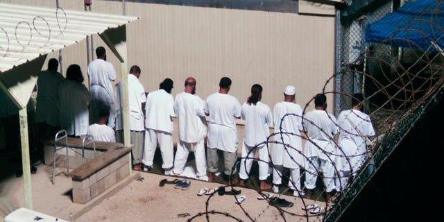 FILE: 2009: Detainees prayer at a detention facility at Guantanamo Bay U.S. Naval Base, in Cuba.