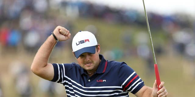 FILE - In this Sunday, Sept. 28, 2014 file photo, Patrick Reed of the US celebrates his birdie and winning the 8th hole during the singles match on the final day of the Ryder Cup golf tournament, at Gleneagles, Scotland. Patrick Reed hasn't received this much attention since he pressed his finger to his lips in Scotland to quiet the Ryder Cup crowd. This time it was his own mouth that got the 24-year-old American into trouble when he berated himself with swearing and a gay slur. Reed apologized on Friday, Nov. 7, 2014 for his outburst at the HSBC Champions, which was captured on live television during the opening round of a World Golf Championship. (AP Photo/Peter Morrison, File)