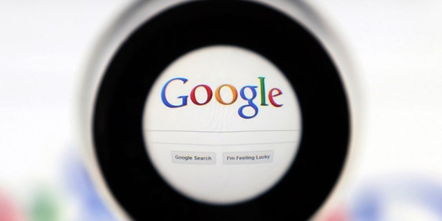 A Google search page is seen through a magnifying glass in this photo illustration taken in Brussels May 30, 2014.