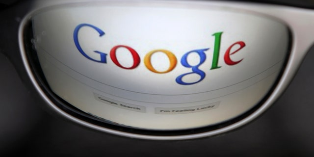A Google search page is reflected in sunglasses in this photo illustration taken in Brussels May 30, 2014. Google has taken the first steps to meet a European ruling that citizens can have objectionable links removed from Internet search results, a ruling that pleased privacy campaigners but raised fears that the right can be abused to hide negative information.   REUTERS/Francois Lenoir (BELGIUM - Tags: POLITICS SCIENCE TECHNOLOGY) - RTR3RK9G