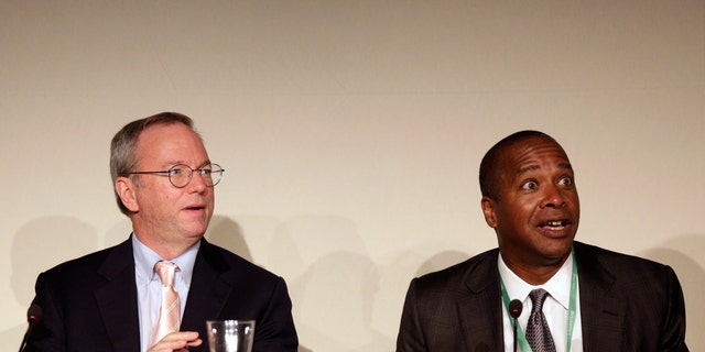 Google Executive Chairman Eric Schmidt (L) and David Drummond, Google's Senior Vice President of Corporate Development, react before a meeting about the 'right to be forgotten,' in Madrid on September 9.