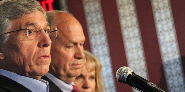 September 2, 2014: Former Alaska Democratic party gubernatorial candidate Byron Mallott, left, appears with independent  candidate Bill Walker, middle, at a news conference in Anchorage. Walker and Mallott will combine on a unified ticket to face Republican Gov. Sean Parnell in the general election. (AP Photo/Mark Thiessen)