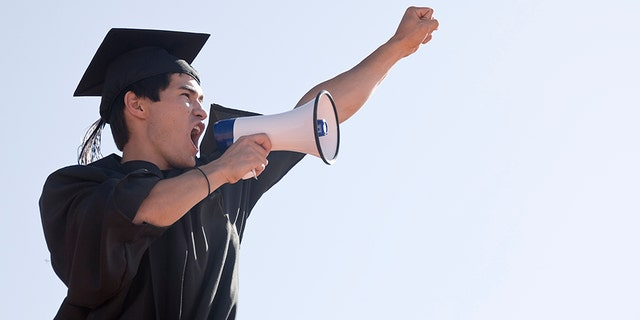 File image of a graduate. Two students at a Catholic high school were told they couldn't give their speeches because they were too political and inconsistent with Catholic teachings, so they delivered them with a bullhorn outside the ceremony instead.