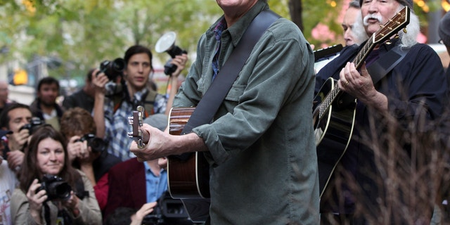 Musicians Graham Nash, second right, and David Crosby perform in Zuccotti Park where Occupy Wall Street campaign demonstrators have been occupying in New York November 8, 2011.