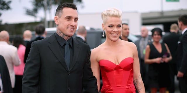 Carey Hart and singer Pink attend the 56th GRAMMY Awards at Staples Center