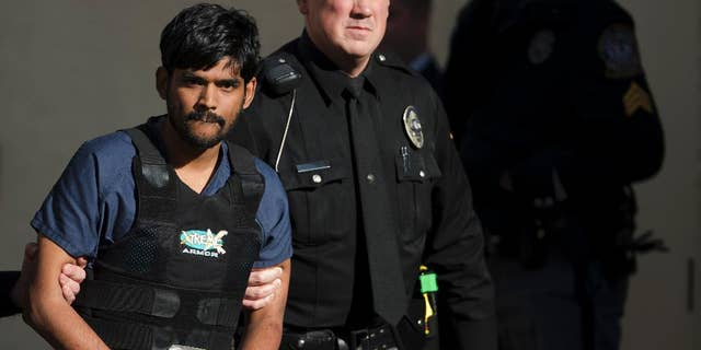 FILE- In this Nov. 28, 2012, file photo, Raghunandan Yandamuri is escorted from a Montgomery County district court after a preliminary hearing in Bridgeport, Pa. Yandamuri, who was sentenced to death in the killings of a baby and her grandmother in what prosecutors call a botched kidnapping plot, said Monday, April 13, 2015, that he's so dissatisfied with his attorneys he'd rather be executed now than continue seeking a new trial with them. (AP Photo/Matt Rourke, File)