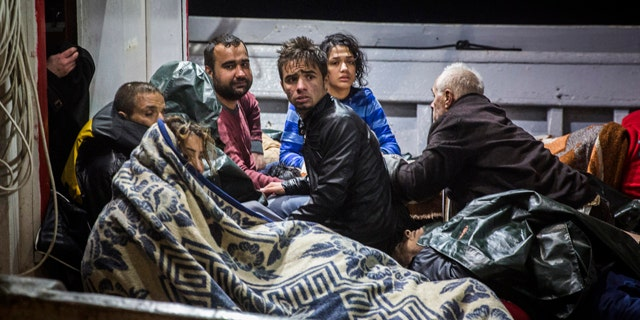 Oct. 28, 2015: Refugees arrive to the port of Molivos on a fishing boat after the boat in which they were crossing the Aegean sea from Turkey to the Greek island of Lesbos sank. (AP Photo/Santi Palacios)