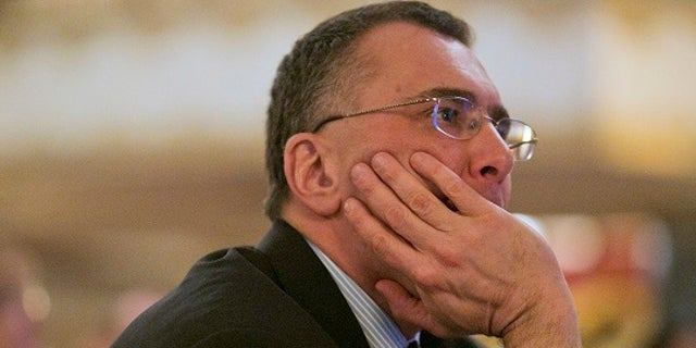 Economist Jonathan Gruber listens during a conference of the Workers Compensation Research Institute in Boston, Massachusetts, March 12, 2014. Dr. Gruber is a professor at MIT and the architect of the healthcare reform laws in Massachusetts and the American Affordable Care Act. REUTERS/Dominick Reuter  (UNITED STATES - Tags: POLITICS BUSINESS) - RTR3GTIN