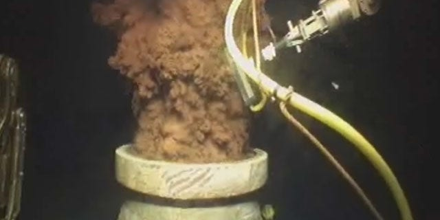 FILE - In this Monday July 12, 2010 image from video made available by BP PLC, oil flows out of the top of the transition spool, which was placed into the gushing wellhead and will house the new containment cap, at the site of the Deepwater Horizon oil spill in the Gulf of Mexico. (AP Photo)