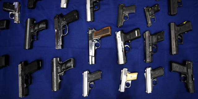 Seized guns are pictured at the police headquarters in New York. (REUTERS/Eric Thayer)