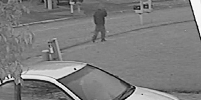Authorities in Indiana released this photo from a home surveillance video that shows the suspect in the murder of Amanda Blackburn.