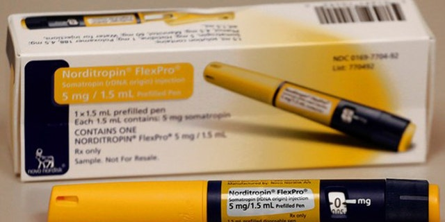 This photo shows an injector filled with human growth hormone, available with a prescription. (AP)