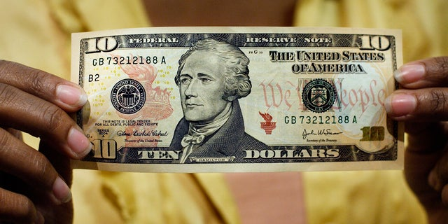 FILE - In this March 2, 2006, file photo, a $10 bill, featuring a likeness of Andrew Hamilton, the first U.S. Treasury secretary, is displayed at the National Archives gift shop, in Washington. U.S. Treasury officials declined to comment Monday, April 18, 2016, on the specifics of a CNN report that Treasury Secretary Jacob Lew has decided to keep Hamilton on the $10 bill, and instead replace seventh U.S. President Andrew Jackson's portrait on the $20 bill with a woman who represents the struggle for racial equality. (AP Photo/J. Scott Applewhite, File)