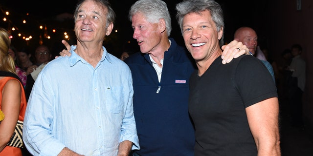 "Actor Bill Murray, left, former U.S. President Bill Clinton, center, and musician Jon Bon Jovi attend the Hamptons Sneak Screening of Open Road Films' ""Rock the Kasbah"" after party on Friday, Aug. 28, 2015 in East Hampton, N.Y."
