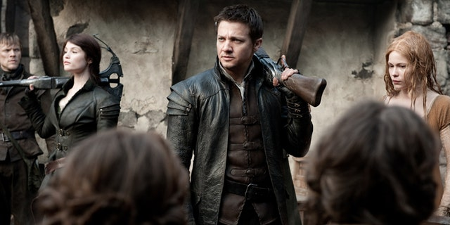 """This film image released by Paramount Pictures shows Gemma Arterton as Gretel, from left, Jeremy Renner as Hansel and Pihla Viitala as Mina, in a scene from """"Hansel & Gretel: Witch Hunters."""""""