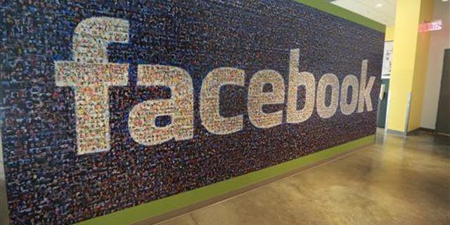 This Nov. 14, 2014, photo shows a board with the Facebook logo inside the new Facebook data centers in Altoona, Iowa.