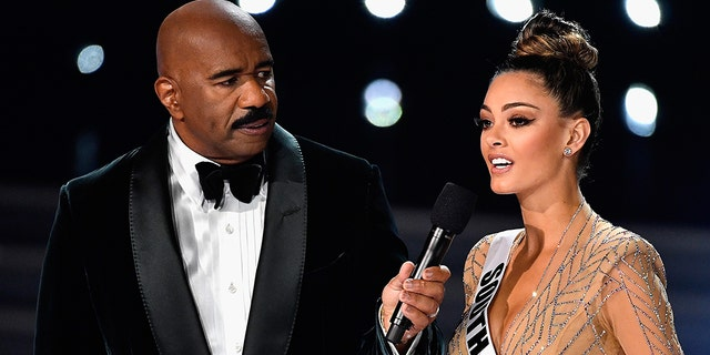 Steve Harvey with Demi-Leigh Nel-Peters at the 2017 Miss Universe pageant.