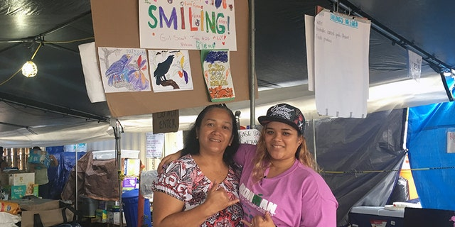 Baylina Kahalepauole (left) works side by side with her daughter, Lilinoe Kahalepauole at the Pu'uhonua o Puna donation center. Both say they've heard from residents displaced and on edge about life in a post-Kilauea world.