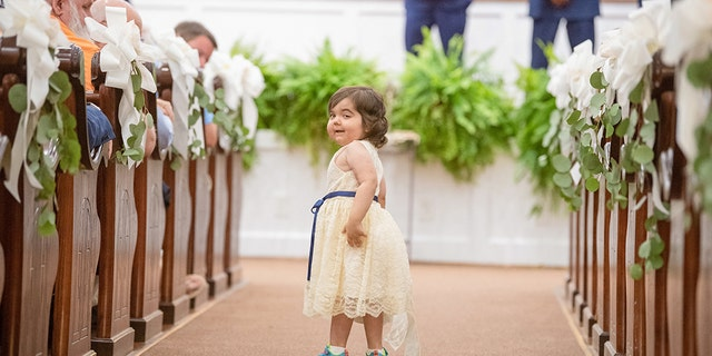Skye's mom said she left the guests in tears as she tossed flowers down the aisle.