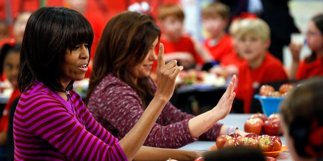 Feb. 27, 2013: First lady Michelle Obama and Food Network chef Rachael Ray discussing lunches with students from the Eastside and Northside Elementary Schools in Clinton, Miss.