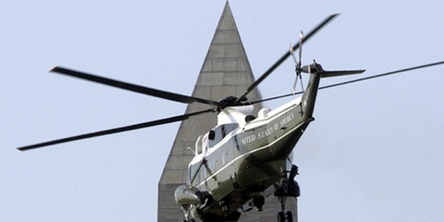 May 1, 2007: The Marine One helicopter carrying passes by the Washington Monument.