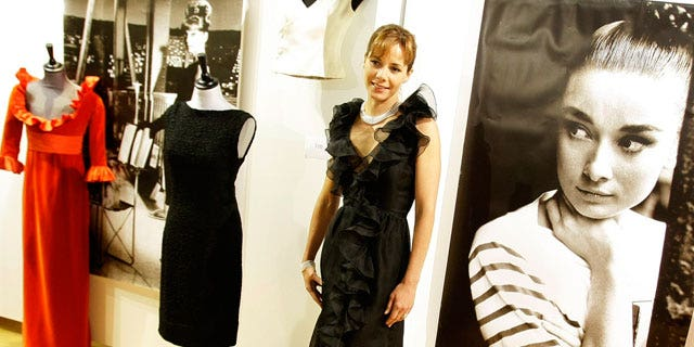 Dec. 7: Former British ballerina Darcey Bussell models a black Valentino haute couture black organza ruffle edge cocktail dress from 1971, in London.