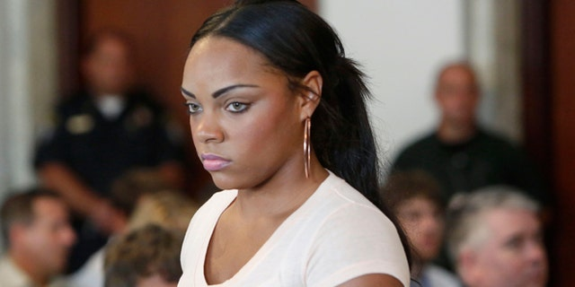 FILE - In this July 24, 2013, file photo, Shayanna Jenkins, girlfriend of former New England Patriot Aaron Hernandez, arrives at hearing for Hernandez at Attleboro District Courtroom in Attleboro, Mass. Jenkins is due to be arraigned Tuesday, Oct. 15, 2013, in Massachusetts on a perjury charge connected to the murder case against Hernandez.  (AP Photo/Bizuayehu Tesfaye, File)