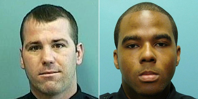 Baltimore Police Detectives Daniel Hersl, left, and Marcus Taylor