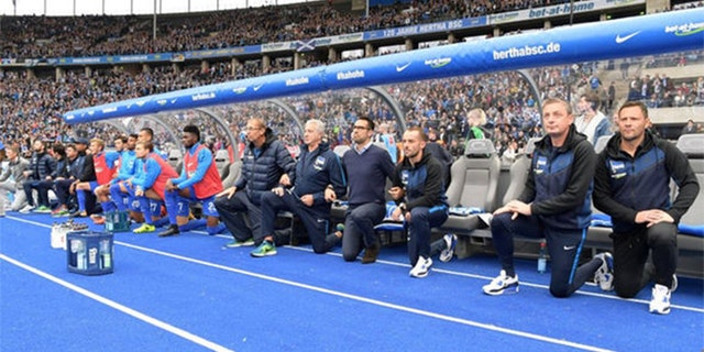 Hertha Berlin's coaching staff also took the knee along with their players