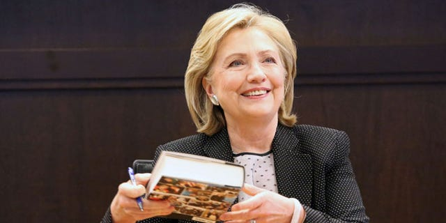 """Former Secretary of State Hillary Clinton signs copies of her new book """"Hard Choices"""" Barnes & Noble at The Grove in Los Angeles Thursday, June 19, 2014."""