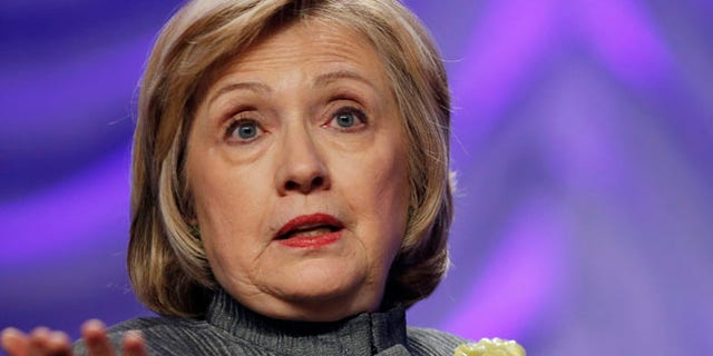 This May 6, 2014 file photo shows Former Secretary of State Hillary Rodham Clinton speaking in National Harbor, Md.