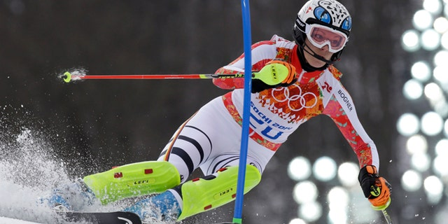 Feb. 10, 2014: Germany's Maria Hoefl-Riesch passes a gate in the slalom portion of the women's supercombined to win the gold medal at the Sochi 2014 Winter Olympics.