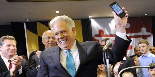 Nov. 5, 2014: Maryland Gov.-elect Larry Hogan, a Republican, gets a call from New Jersey GOP Gov. Chris Christie, Annapolis, Md.