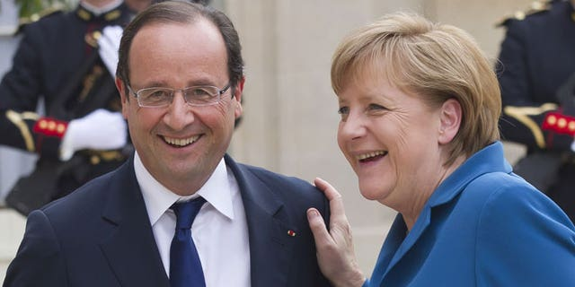 June 27, 2012: French President Francois Hollande, left, welcomes German Chancellor Angela Merkel at the Elysee Palace.