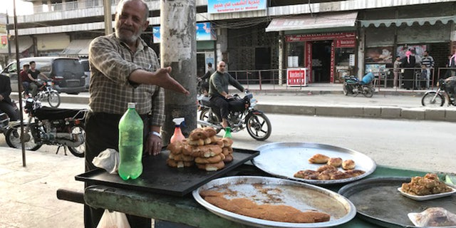 Mahmoud, a 60-year-old sweets seller, was grateful about being spared the aerial bombardment that has ravaged much of Syria.