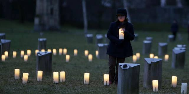 Israelis and people around the world mark Holocaust Remembrance Day on Wednesday, April 15, 2015. A child is pictured at a commemoration ceremony at the Jewish Cemetery in the former Nazi concentration camp Terezin, in Terezin, Czech Republic, on International Holocaust Remembrance Day, Jan. 27, 2015.