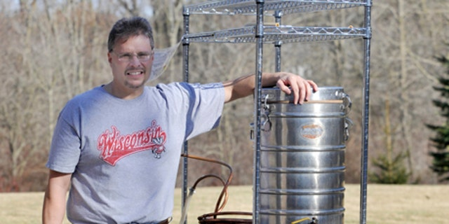 March 10, 2012: Kevin Flynn, 46, of Caledonia, Wis., poses with some of his home brewing equipment. An explosion of interest in home beer brewing is forcing lawmakers across the country to review long-forgotten alcohol laws, some of which date back to Prohibition. (AP Photo/Journal Times, Gregory Shaver)