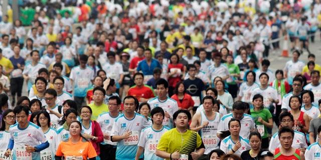 Feb. 24, 2013: Participants run on the Eastern Corridor expressway during a 10-kilometer race as part of the Hong Kong Marathon.